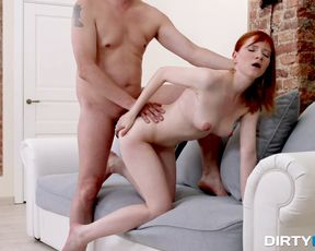 Pale redhead from Russia gets screwed on the couch